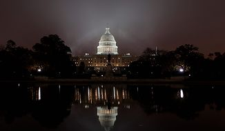 Fog envelopes Capitol Hill in Washington,  at dawn Monday, Nov. 15, 2010, as Congress begins its lame duck session following a long break for the midterm elections. (AP Photo/J. Scott Applewhite)