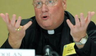 ASSOCIATED PRESS PHOTOGRAPHS Archbishop Timothy Dolan of New York speaks at a news conference after being elected president of the U.S. Conference of Catholic Bishops during the conference's annual fall meeting Tuesday in Baltimore. It marked the first time since the 1960s that the sitting vice president was not elected.
