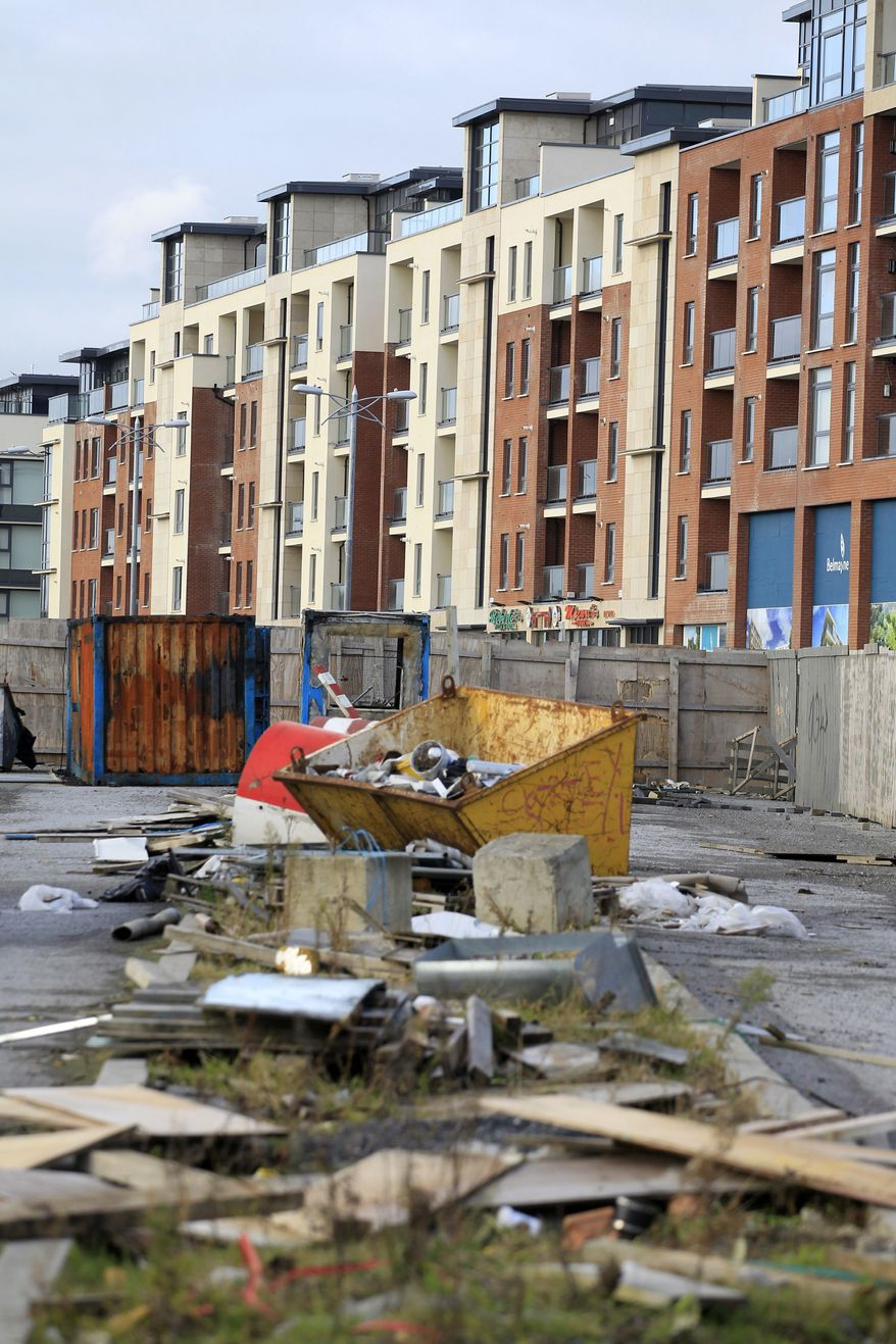 Associated Press A building site where the remaining apartments of a development were to have been built sits idle on the outskirts of Dublin on Monday. Debt-burdened Ireland is talking with other European Union governments about how best to handle its troubled finances, officials said.