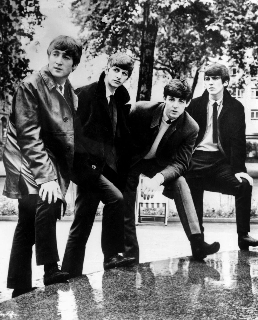 In this undated file photograph British pop band The Beatles, John Lennon (left) Ringo Starr, Paul McCartney and George Harrison (right) pose for a photograph. Apple Inc. said Tuesday, Nov. 16, 2010, its iTunes service will sell music from the Fab Four. The Beatles have so far been the most prominent holdout from iTunes and other online music services. (AP Photo/file)