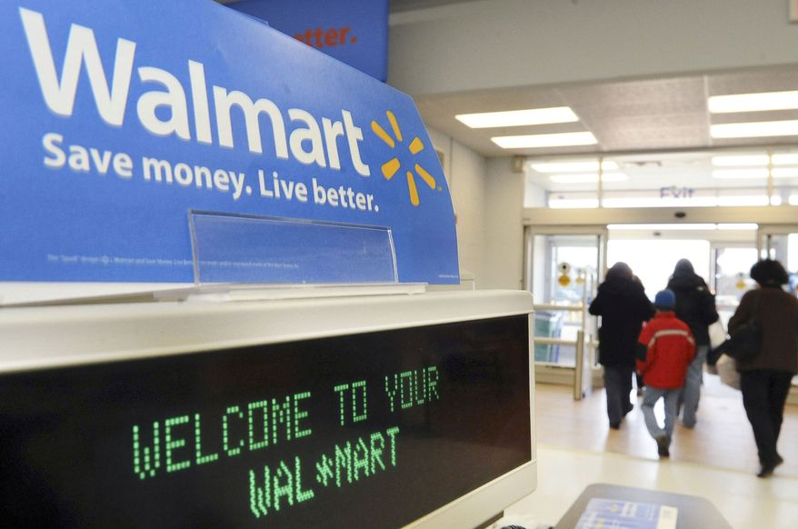 In this Feb. 17, 2009, file photo, shoppers leave a Wal-Mart in Danvers, Mass. Wal-Mart Stores Inc. is reporting a 9.3 percent increase in third-quarter net income Tuesday, Nov. 16, 2010, as the world's largest retailer benefits from cost controls and a robust international business. (AP Photo/Lisa Poole, File)