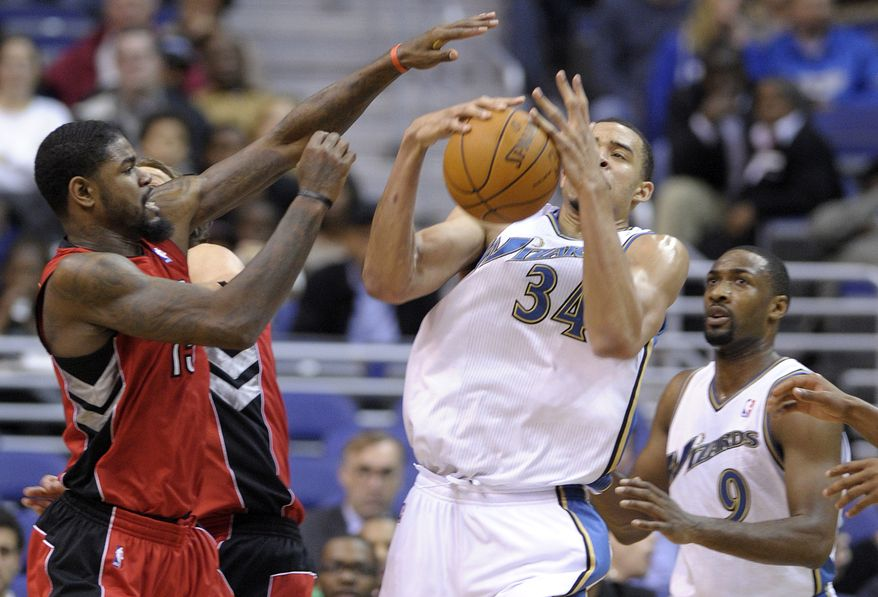ASSOCIATED PRESS Washington Wizards center JaVale McGee (34) tries to grab the ball before Toronto Raptors forward Amir Johnson, left, can during the first half of their NBA basketball game at the Verizon Center in Washington, Tuesday, Nov. 16, 2010.