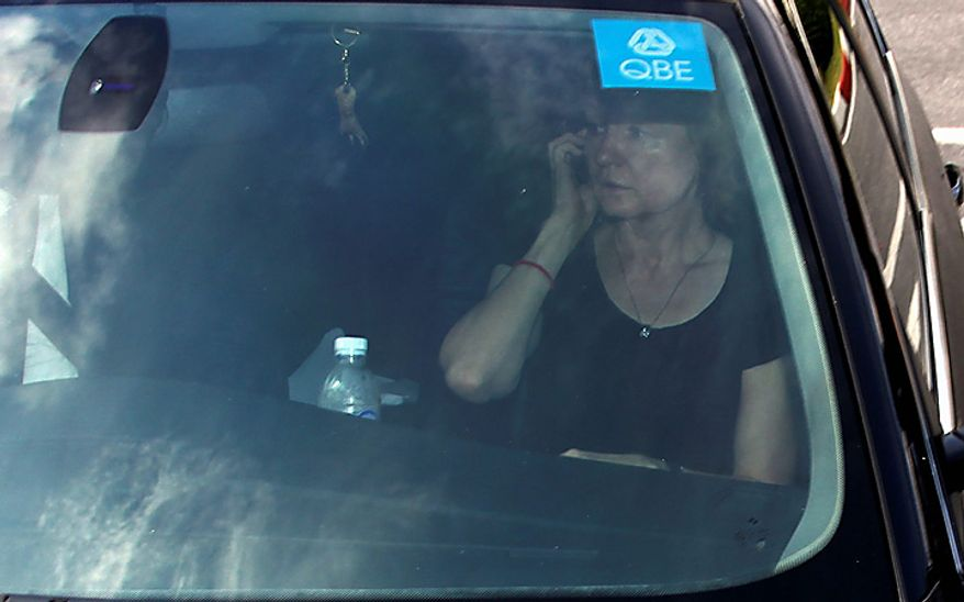 Alla Bout, wife of suspected Russian arms smuggler Viktor Bout, talks on cell phone before leaving Don Muang airport in Bangkok on Tuesday,  Nov 16, 2010.  The Thai government extradited accused Russian arms trafficker Viktor Bout to the United States on Tuesday to face terrorism charges, rejecting heavy pressure from Moscow for him to be freed.  (AP Photo)