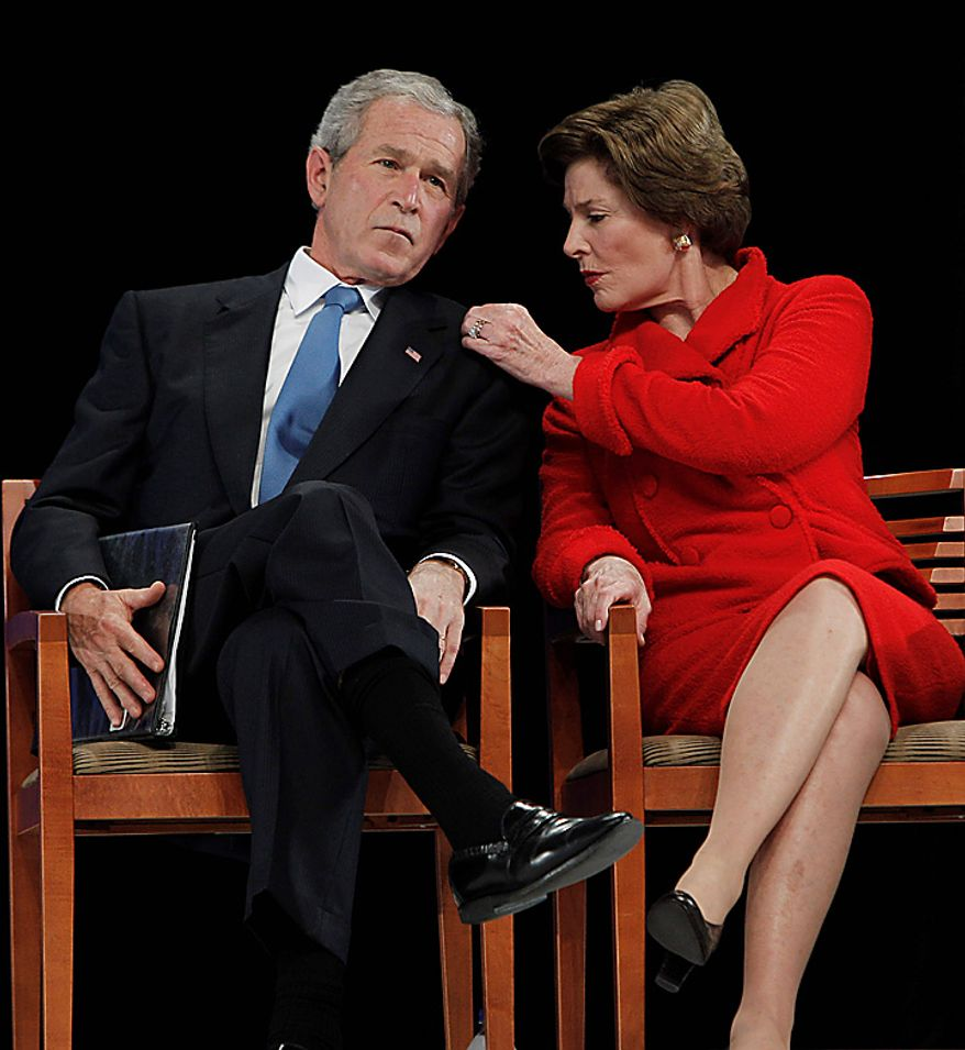Laura Bush, right, and former President George W. Bush attend the ground breaking ceremony for the President George W. Bush Presidential Center at SMU in Dallas, Tuesday, Nov. 16, 2010. (AP Photo/LM Otero)