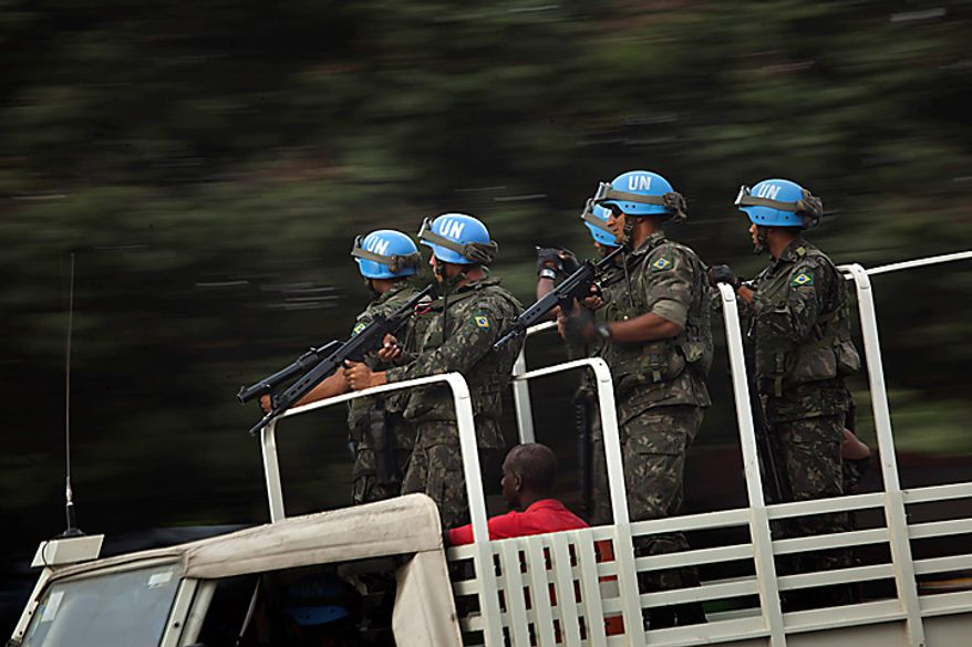 UN peacekeepers from Brazil patrol in Port-au-Prince, Haiti, Monday Nov. 15, 2010.  Protesters who hold Nepalese U.N. peacekeepers responsible for an outbreak of cholera that has killed 1,000 in three weeks threw stones and threatened to set fire to a base in Cap-Haitien, the country's second-largest city Monday, Haitian radio and eyewitnesses reported.(AP Photo/Emilio Morenatti)