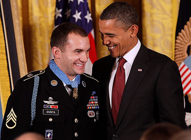 President Barack Obama smiles after he presented the Medal of Honor to Army Staff Sgt. Salvatore Giunta during a ceremony in the East Room of the White House in Washington, Tuesday, Nov. 16, 2010. Giunta, from Hiawatha, Iowa, is the first living veteran of the wars in Iraq and Afghanistan to receive the award. (AP Photo/Charles Dharapak)