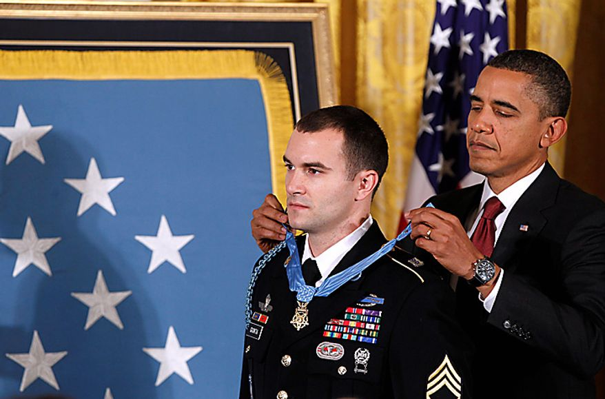 President Barack Obama presents the Medal of Honor to Army Staff Sgt. Salvatore Giunta during a ceremony in the East Room of the White House in Washington, Tuesday, Nov. 16, 2010. Giunta, from Hiawatha, Iowa, is the first living veteran of the wars in Iraq and Afghanistan to receive the award. (AP Photo/Charles Dharapak)
