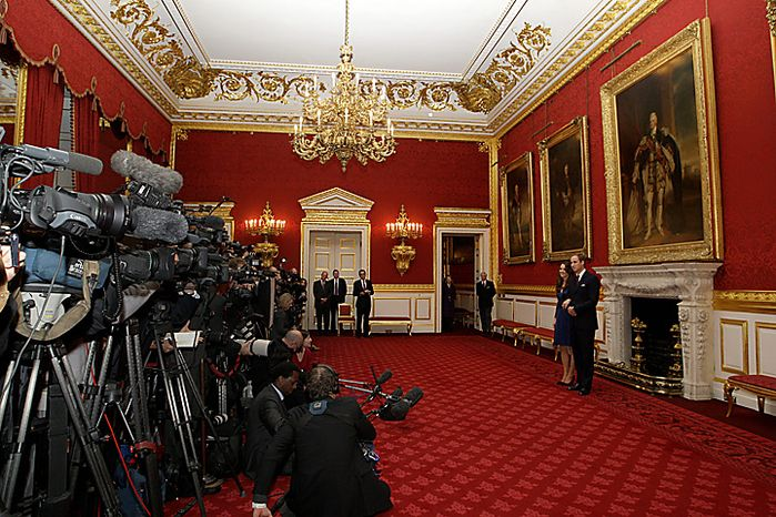 Britain's Prince William and his fiancee Kate Middleton  pose for the media  at St. James's Palace in London, Tuesday Nov. 16, 2010, after they announced their engagement. The couple are to wed in 2011. (AP Photo/Sang Tan)