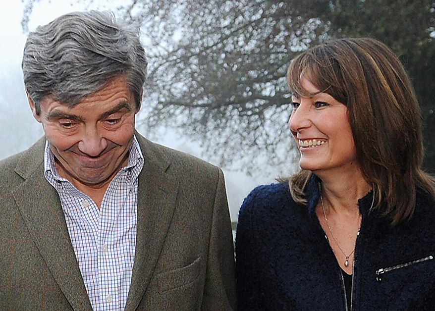 Michael and Carole Middleton, the parents of Kate Middleton,  make a statement on the engagement of their daughter to Britain's Prince William, outside their home near the village of Bucklebury, England, Tuesday Nov. 16, 2010. Royal officials announced that Prince William, who is second in line to the throne, and  Middleton will marry next spring or summer in London.(AP Photo/Stefan Rousseau/ pool)