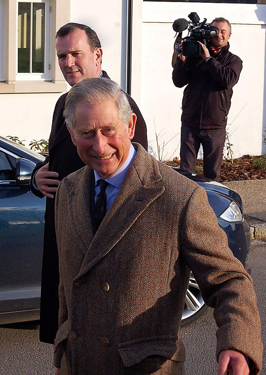 """Britain's Prince Charles smiles  during a visit to Poundbury in southwest England  Tuesday Nov, 16, 2010. The Prince said he was """"thrilled"""" by the engagement of his son Prince William and Kate Middleton. (AP Photo/Ben Mitchell/PA)"""