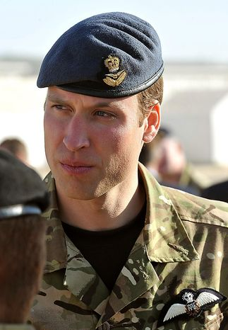 Britain's Prince William talks to soldiers before a remembrance day ceremony at Camp Bastion in southern Afghanistan, Sunday Nov. 14, 2010. Clarance House announced in London, Tuesday Nov. 16, 2010, that Prince William and Kate Middleton are engaged, and will be married in 2011. (AP Photo/John Stillwell, pool)
