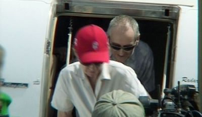 Paul and Rachel Chandler arrive Sunday at Mogadishu's airport in Somalia after being released earlier from 388 days of captivity by pirates.