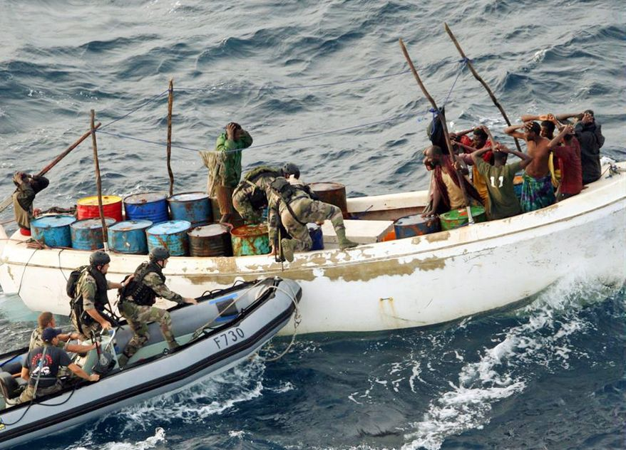 French soldiers arrest suspected pirates off the coast of Somalia in November 2009. The influx of millions of dollars in ransoms has changed life in some coastal communities in Somalia, driving prices up and creating a schism between the pirate-haves and the local have-nots.