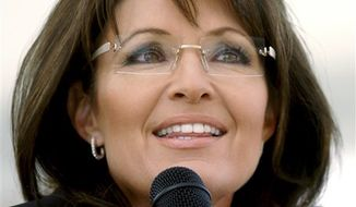 FILE - In this Oct. 30, 2010 file photo, former Alaska Gov. Sarah Palin stumps for Republican candidate for Senate, John Raese, during a rally at Haddad Riverfront Park in Charleston, W.Va. (AP Photo/Jon C. Hancock, file)