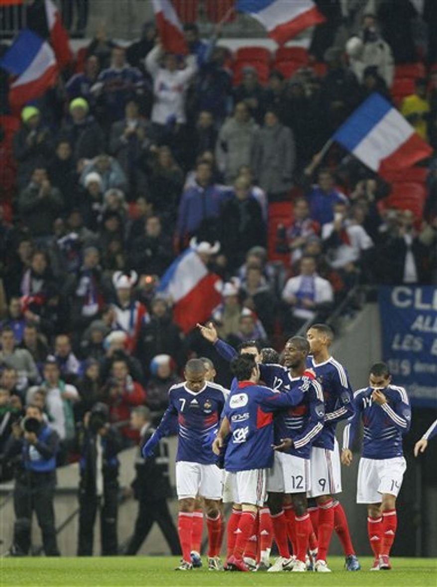 France's Karim Benzema, second right, scores during the international soccer friendly match between England and France at Wembley Stadium in London, Wednesday, Nov. 17, 2010. (AP Photo/Kirsty Wigglesworth)