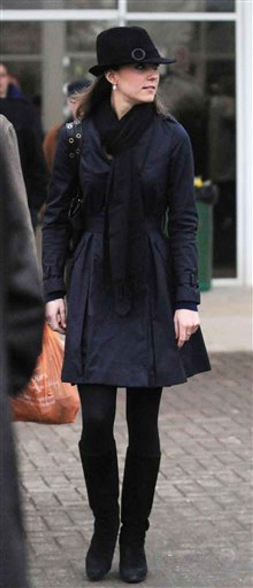 """FILE - In this March 14, 2008 file photo, Kate Middleton, the girlfriend of Britain's Prince William, leaves Cheltenham Racecourse in Cheltenham, England. Until she spoke out about her love for the 28-year-old prince and her admiration for his mother, the late Princess Diana, on the day their engagement was announced, Middleton had kept totally mum about her relationship and her thoughts about joining """"The Firm,"""" as the royal family is popularly known. (AP Photo/PA Wire, Barry Batchelor)  UNITED KINGDOM OUT"""