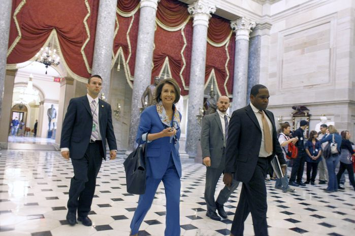 House Speaker Nancy Pelosi walks through Statuary Hall on Capitol Hill in Washington, Tuesday, Nov. 16, 2010. (AP Photo/Harry Hamburg)