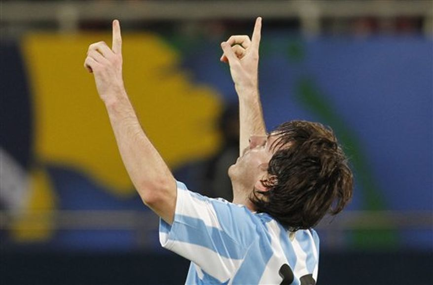 Argentina's Lionel  Messi celebrates after scoring against Brazil during a friendly soccer match in Doha, Qatar, Wednesday, Nov. 17, 2010. (AP Photo/Bernat Armangue)