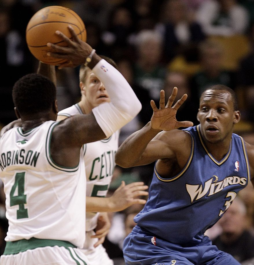 ASSOCIATED PRESS Washington Wizards guard Lester Hudson (3) attempts to stop Boston Celtics point guard Nate Robinson (4) from passing during the second half of their NBA basketball game at the Garden in Boston, Wednesday night, Nov. 17, 2010. The Celtics defeated the Wizards 114-83.