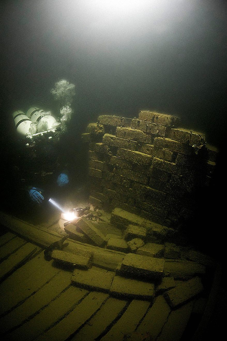 A diver inspects 200-year-old bottles of Champagne at the site of a shipwreck in the Baltic Sea in this undated photo released to the media on Nov. 17, 2010. The world's oldest Champagne was discovered in July in a shipwreck, 50 meters (yards) below the surface, in the waters south of Aaland, a Finnish-controlled archipelago of 6,500 islands in the Baltic sea. Photographer: Alex Dawson/Aalands Landskapsregering via Bloomberg