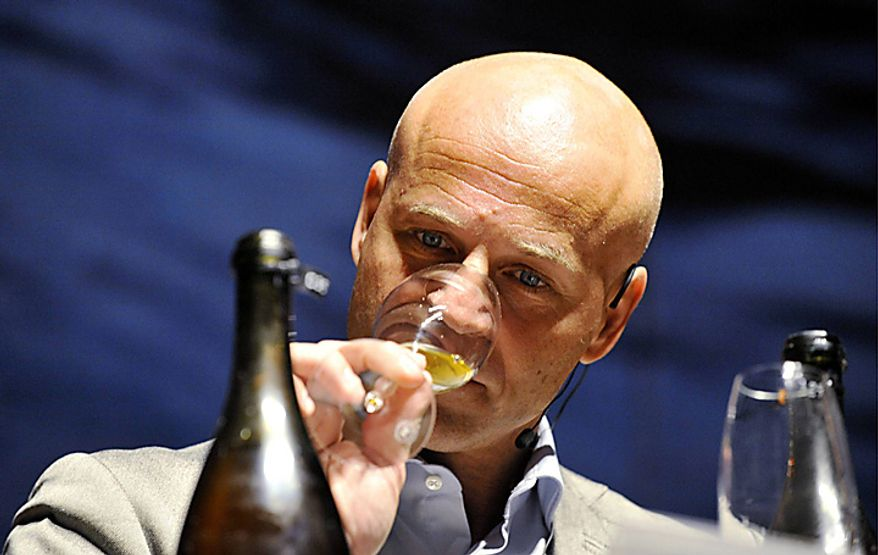 The world's leading champagne expert Richard Juhlin samples one of the 168 bottles of champagne salvaged from a 200-year-old shipwreck in the waters off Aland Islands, between Sweden and Finland, which was opened at a sampling in Mariehamn, Finland on Wednesday Nov. 17, 2010. The divers originally said the bottles were believed to be from the 1780s but experts later dated the champagne to the early 19th century and could be the world's oldest drinkable champagne.  (AP Photo/Lehtikuva/Jussi Nukari)