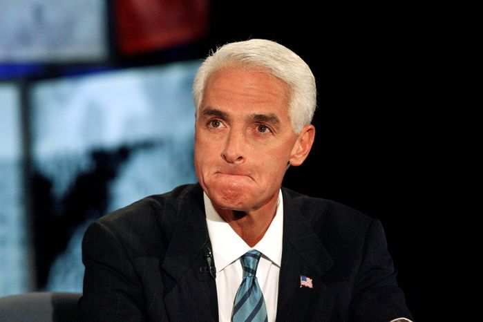 FILE - Florida senate candidate Gov. Charlie Crist participates in a gubernatorial debate at the University of South Florida, in Tampa, Fla.,in this Oct. 24, 2010 file photo. The outgoing Florida Gov. Charlie Crist Crist told the St. Petersburg Times Tuesday Nov. 16, 2010 he is looking to pardoning the long-dead rocker Jim Morrison who was convicted of exposing himself at a raucous 1969 concert in Miami. (AP Photo/Joseph Garnett, Jr., File)