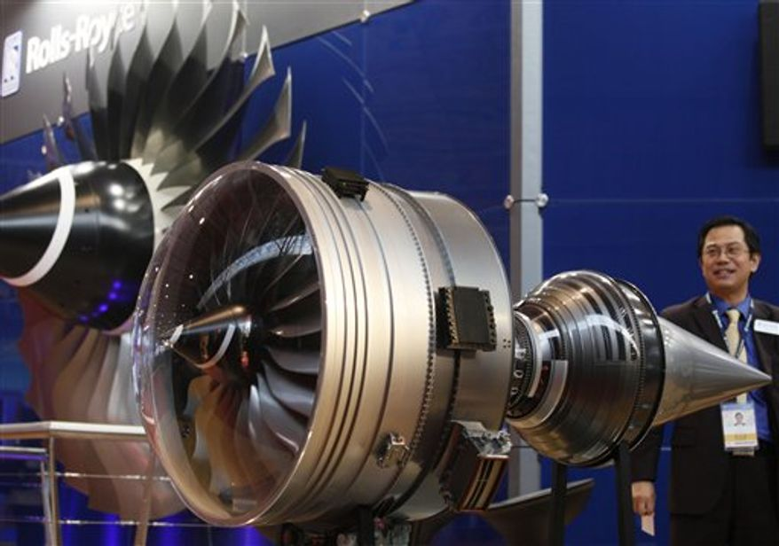 Parts of a Rolls-Royce engine are displayed at the 8th China International Aviation and Aerospace Exhibition (Zhuhai Airshow) in Zhuhai, southern coast of Guangdong province, China, Tuesday, Nov. 16, 2010. Rolls-Royce will temporarily replace any oil-leaking engines like the one that caught fire and blew apart on a Qantas superjumbo jet earlier this month, and aviation official said Monday. Qantas said it found oil leaks in three of its Airbus A380s powered by the Rolls-Royce engines. Its entire fleet of six remains grounded since the blowout on the flight to Sydney, which forced the safe return of the jet to Singapore. The airshow will run from Nov. 16 to 21. (AP Photo/Kin Cheung)