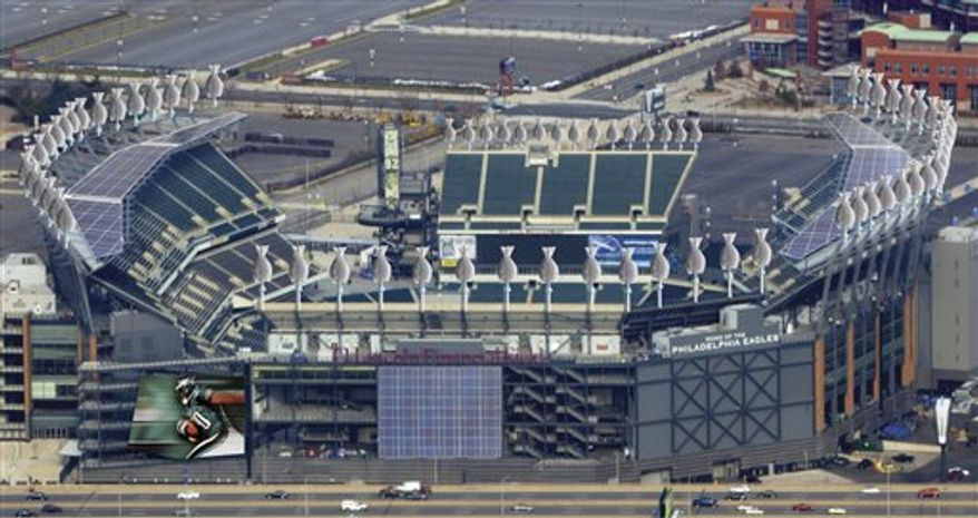 In this artist rendering provided by the Philadelphia Eagles and Solar Blue on Thursday, Nov. 18, 2010, Lincoln Financial Field in Philadelphia is shown after it undergoes renovations that will make the stadium self-sufficient and let the Eagles sell some power back to the electric grid.  (AP Photo/The Philadelphia Eagles and Solar Wind)