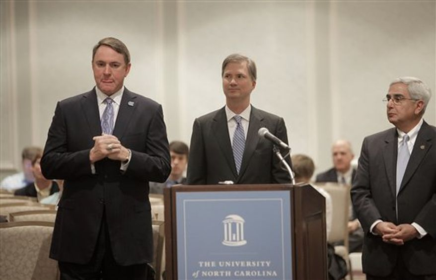 UNC head football coach Butch Davis, left, addresses the University of North Carolina Board of Trustees regarding recent investigations into misconduct on the UNC football team, at the Carolina Inn in Chapel Hill on Thursday, Nov. 18, 2010. Standing nearby are UNC Chancellor Holden Thorp, center, and UNC athletics director Dick Baddour, right. (AP Photo/The News & Observer, Ted Richardson)