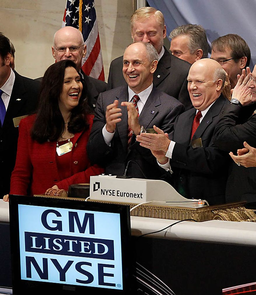 General Motors Co. CEO Dan Akerson, right, and other dignitaries celebrate after ringing the opening bell at the New York Stock Exchange in New York, Thursday, Nov. 18, 2010.  (AP Photo/Seth Wenig)