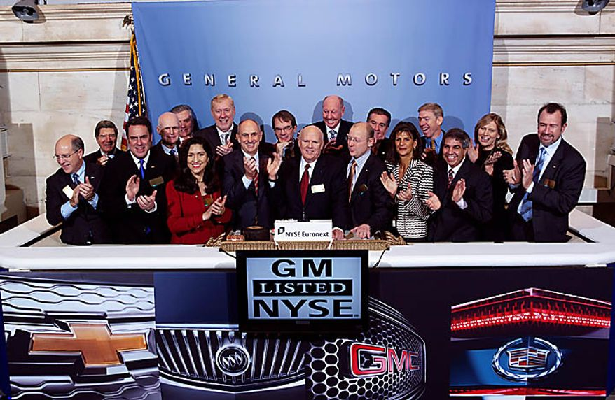 In this photo provided by the New York Stock Exchange, General Motors CEO Daniel Akerson, center, rings the NYSE opening bell with other GM executives Thursday, Nov. 18, 2010 in New York. General Motors stock began trading on Wall Street again Thursday, signaling the rebirth of an American corporate icon that collapsed into bankruptcy and was rescued with a $50 billion infusion from taxpayers. (AP Photo/New York Stock Exchange, Ben Hider) NO SALES