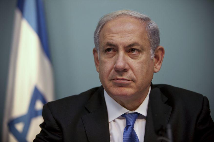 Israeli Prime Minister Benjamin Netanyahu listens during a press conference in Jerusalem, Monday, Nov. 15, 2010. (AP Photo/Tara Todras-Whitehill)