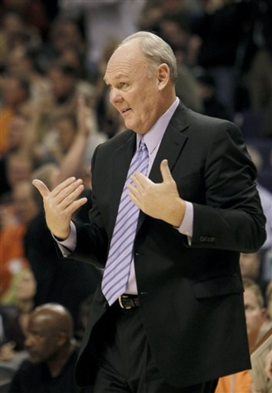 Denver Nuggets coach George Karl talks to his players while they are on defense against the Phoenix Suns during the fourth quarter of an NBA basketball game Monday, Nov. 15, 2010, in Phoenix. The Suns defeated the Nuggets 100-94. (AP Photo/Ross D. Franklin)