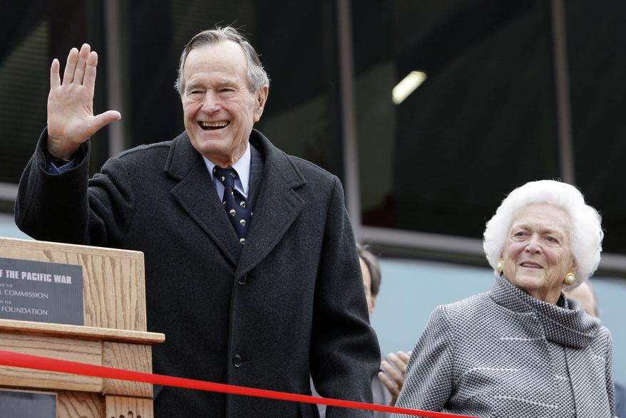 In this Dec. 7, 2009, file photo, former President George H.W. Bush and former first lady Barbara Bush arrive for a ceremony to dedicate an expanded gallery that carries his name at the National Museum of the Pacific War, in Fredericksburg, Texas. On Wednesday, President Obama named the former president a recipient of the Presidential Medal of Freedom (AP Photo/Eric Gay, File)
