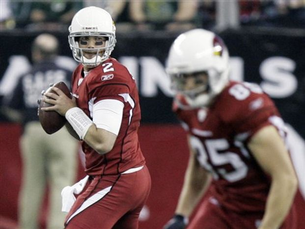 FILE- In this Jan. 3, 2010, file photo, Arizona Cardinals quarterback Brian St. Pierre (2) drops back to pass against the Green Bay Packers during the second half on an NFL football game in Glendale, Ariz. St. Pierre has thrown five passes in eight NFL seasons. On Sunday, he'll start for the Carolina Panthers, who signed him to the practice squad last week. He was promoted to the 53-man roster on Tuesday, after injuries to QBs Matt Moore and Jimmy Clausen.(AP Photo/Paul Connors, File)