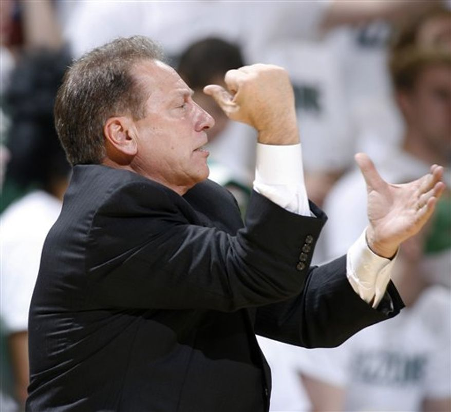 Michigan State coach Tom Izzo gestures during the second half of an NCAA college basketball game against South Carolina, Tuesday, Nov. 16, 2010, in East Lansing, Mich. Michigan State won 82-73. (AP Photo/Al Goldis)