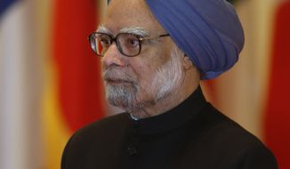 ** FILE ** Indian Prime Minister Manmohan Singh arrives for the opening plenary session of the G-20 summit at in Seoul on Friday, Nov. 12, 2010. (AP Photo)
