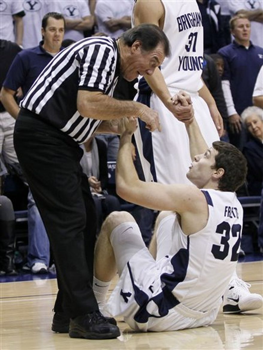 BYU's Kyle Collinsworth (31) attempts to score over Utah State's Pooh Williams (5) during the first half of an NCAA college basketball game on Wednesday, Nov. 17, 2010, in Provo, Utah. (AP Photo/Colin E Braley)