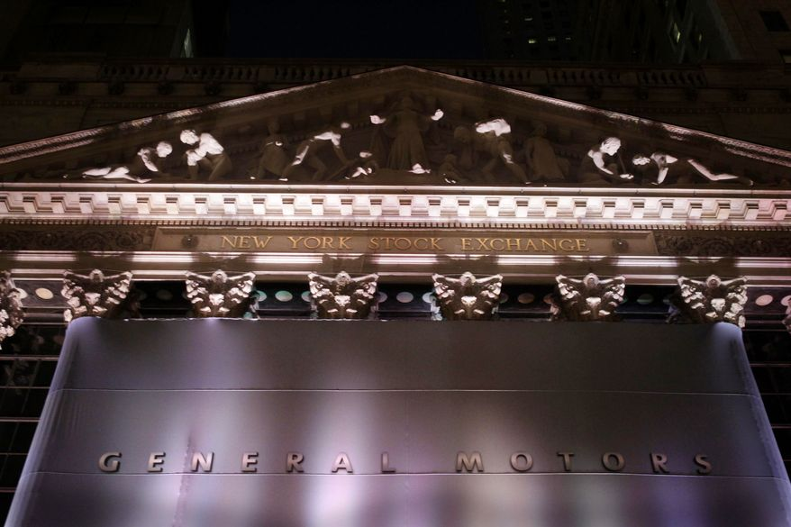 A banner displaying the name of General Motors covers the New York Stock Exchange in New York, Thursday, Nov. 18, 2010. (AP Photo/Seth Wenig)