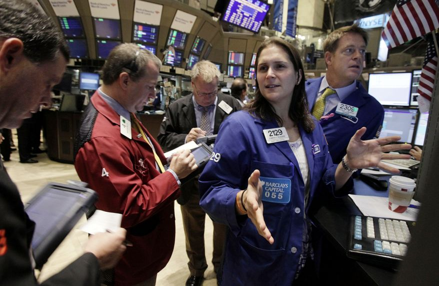 In this Nov. 3, 2010, photo, specialist Jennifer Klesaris works at her post on the floor of the New York Stock Exchange. Confidence that Ireland will work out the details for a bailout and strong interest in General Motors' initial public offering lifted stocks Thursday, Nov. 18, 2010. (AP Photo/Richard Drew)