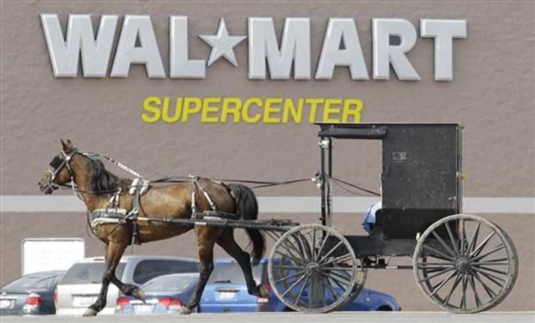 FILE -- A June 23, 2010 file photograph, shows an Amish buggy driving  away from the Walmart store in Middlefield, Ohio.  Medicare's 2010 open enrollment season just started, and the plan from insurer Humana and retail giant Walmart is getting attention. (AP Photo/Amy Sancetta/file)