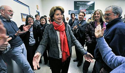 U.S. Sen. Lisa Murkowski greets supporters at the Laborers International Hall, Wednesday, Nov. 17, 2010 in Anchorage, Alaska  (AP Photo/Michael Dinneen)