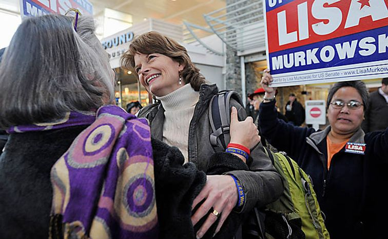U.S. Senator Lisa Murkowski  (R) Alaska, center, is greeted by her sister Carol Sturgelewski, left, upon her arrival at Ted Stevens International Airport in Anchorage Wednesday, Nov. 17, 2010.  Murkowski became the first Senate candidate in more than 50 years to win a write-in campaign.   The victory is a remarkable comeback for Murkowski, who lost to political newcomer Joe Miller in the GOP primary, and a humbling moment for Sara Palin, the former Alaska governor, 2008 GOP vice presidential candidate and Murkowski nemesis whose support was not enough to get Miller through an election in her own backyard.  (AP Photo/Michael Dinneen)