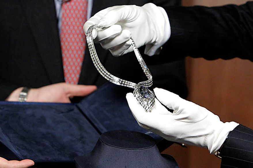 """The Hope Diamond is seen in its unveiling of its new temporary setting, """"Embracing Hope,"""" Thursday, Nov. 18, 2010, at the Smithsonian's National Museum of Natural History in Washington. The temporary setting is platinum with 340 baguette diamonds and took more than eight months to create. (AP Photo/Ann Heisenfelt)"""