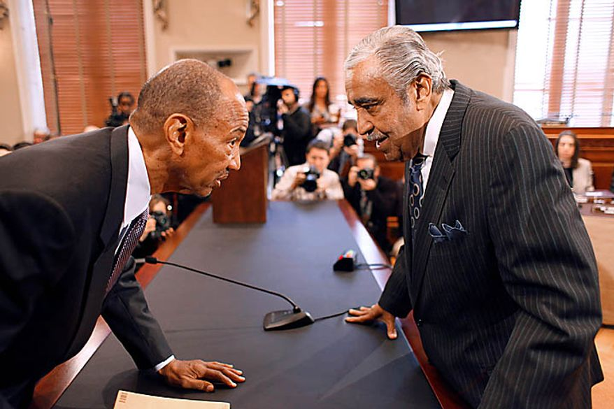 Rep. Charles Rangel, D-N.Y., right, talks with his Chief of Staff George Henry, as Rangel appeared before the House Ethics Committee, on Capitol Hill in Washington, Thursday, Nov. 18, 2010. (AP Photo/Harry Hamburg)