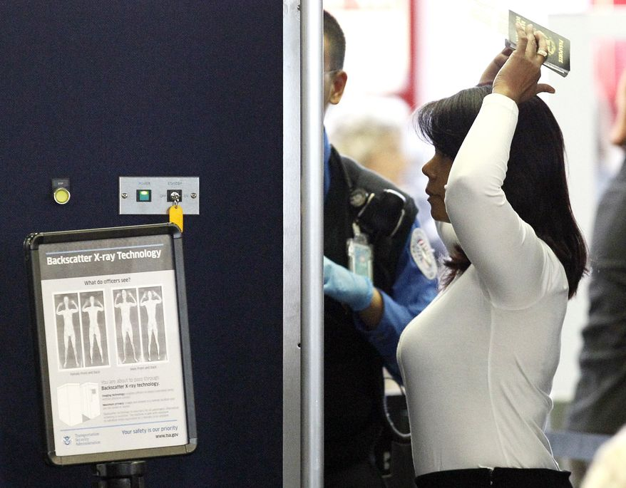 An airline passenger undergoes a full body scan at O'Hare International Airport Wednesday, Nov. 17, 2010 in Chicago. (AP Photo/Charles Rex Arbogast)