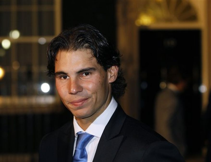 Spanish tennis player Rafael Nadal is seen after attending a reception with the British Prime Minister at Downing Street in London, Thursday, Nov. 18, 2010. The ATP World Tour tennis finals will be held in London at the O2 Arena starting Sunday, Nov. 22. (AP Photo/Kirsty Wigglesworth)