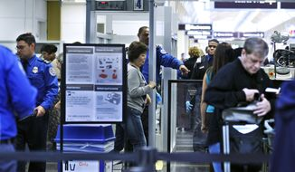 Transportation Security Administration officers (in blue uniforms) screen airline passengers at Ronald Reagan Washington National Airport on Monday, Nov. 15, 2010. (AP Photo/Manuel Balce Ceneta)
