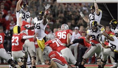 FILE - In this Nov. 14, 2009, file photo, Ohio State kicker Devin Barclay (23) kicks a 39-yard field goal in overtime to beat Iowa 27-24 in an NCAA college football game in Columbus, Ohio. It's been a year since Barclay's big kick, and No. 8 Ohio State and No. 21 Iowa, who meet again on Saturday, certainly haven't forgotten. (AP Photo/Amy Sancetta, File)
