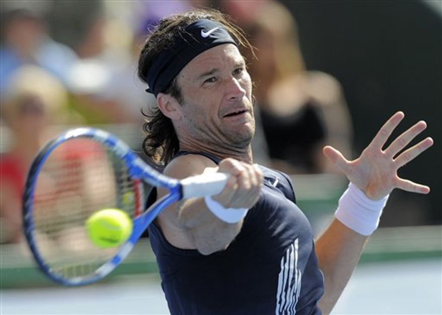 FILE - This Jan. 16, 2009, file photo shows Spain's Carlos Moya making a forehand return against Croatia's Ivan Ljubicic during the Kooyong Classic tennis tournament in Melbourne, Australia. Moya has retired, citing a nagging foot injury in calling an end to his 15-year career. The former No. 1 announced his decision Wednesday, Nov. 17, 2010, saying that differing medical opinions on how to resolve the lingering injury had left him with little option but to retire.  (AP Photo/Andrew Brownbill, File)